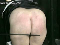 Horny nun slave is spanked on her big ass and hands by older master priest