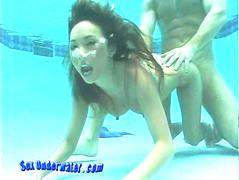 Bamboo sucks and fucks underwater and her nipples are excited and erect