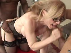 Nina Hartley gets rough handled by two horny black sytuds