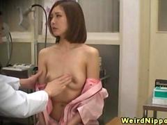Asian babes spied on during a breast exam