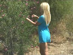 Blonde honey strokes her swollen clit in public