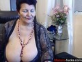 busty ass mature lady on a webcam makes some cash