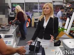 Blonde business woman sucks cock in a pawn shop office
