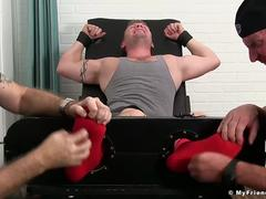 Hot muscle guy Jake Karhoff immobilized and tickled hard