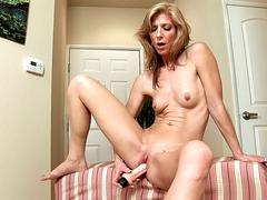 Mature slut is delighted to tease in front of webcam naked and starts playing with her favorite dildo