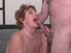 Brunette mature gets fucked in doggy style