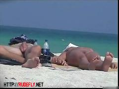 Naked tourists caught on beach spy cam relaxing and enjoying nudity