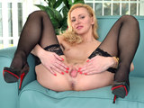 Blonde mommy in sexy lingerie is teasing on a webcam and touch her self