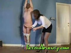 Cute milf jerks off a guy hanged by his wrists