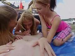 Three horny teens sucking a dick in public domain