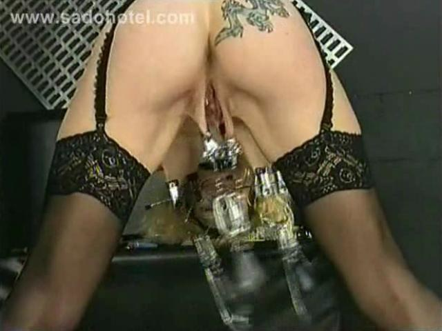 Master puts large metal clamps with weights on pussy lips ...
