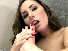 Sexy beauty sucking her toes