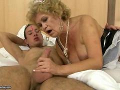 Granny in maid a outfit fucking a horny guy