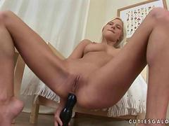 utie fucks her pussy and ass with huge dildo