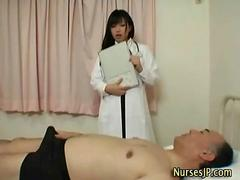 Horny jap nurse gives handjob