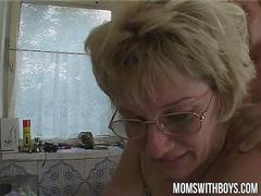 Blonde gilf gets boned in her kitchen by her lover