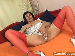 Naked gilf with a splendid corset masturbates