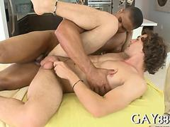 Black masseur bones his curly gay client