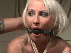 Mature blonde gets bondaged and anal fucked