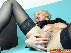 Blond haired mature with a dildo doing her thing
