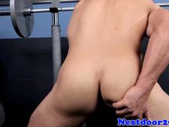 Athletic homo hunk tugs cock in the gym