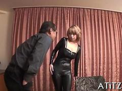 Japanese bimbo in leather suit toyed in vibrator gang bang