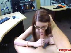 Petite redhead with glasses visits a pawn shop for some action