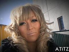 Blonde tanned Japanese slut with long nails vibrates her pussy