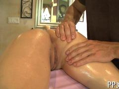 very beautiful blonde on a massage table getting wet