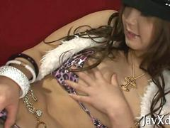 Japanese chick finger banging her pussy wearing leather boots