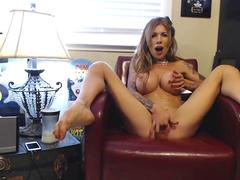 MILF with big fake tits fingering her pussy butt naked