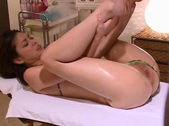lifting her legs up so she welcomes his cock in her