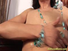 A brunette busty granny is teasing naked and masturbating alone using her favorite vibrator