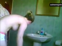 A kinky voyeur is watching his step sister stripping down and taking a bath