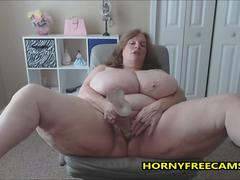 Fat cunt is teasing naked and masturbating with her favorite toys on a webcam