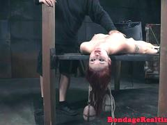 Suspended redhead clit punished with electro