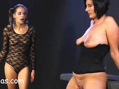 Young dominatrix punishes girl with big tits