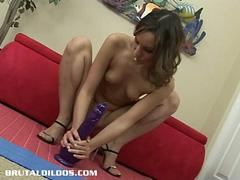 Nympho Amber Rayne double dildo penetrating her holes