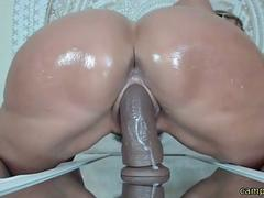 MILF riding a huge dildo with big ass