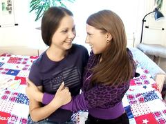 Young lesbian babes Candy C and Vanda L fuck on the bed by Sapphic Erotica