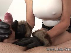 MILF Sonia jerks off guy with leather gloves