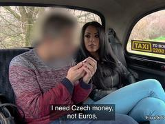 Big tits dark haired babe fucks in fake taxi