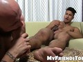 Handsome stud Ken Ott works on his dick while feet worshiped