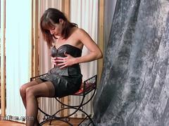 Watch hot Milf strips off soft black leather outfit to reveal sexy thong nylons corset high heels