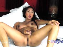 Busty Pi Ladyboy Masturbation and cumming laying on her bed