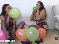 Horny fetish lesbians rubbing popping balloons on each other in nylons and lingerie