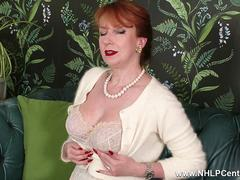 Redhead Milf masturbates in high end retro chic lingerie seamed nylons and designer heels