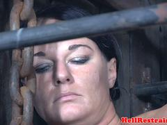 Restrained MILF gets caged and restrained
