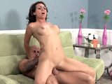 Brunette milf with big tits rides a cock